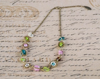 Teal, amber, soft pink, lime green, antique ivory and gold Maasai beadwork necklace