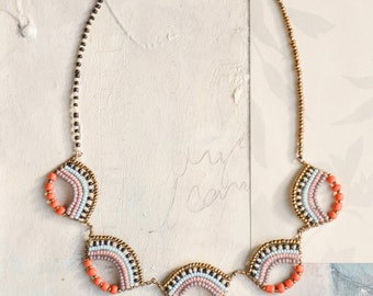 Delicate Maasai bead-work scallop necklace in bright orange, pastels and gold with a tribal influence.