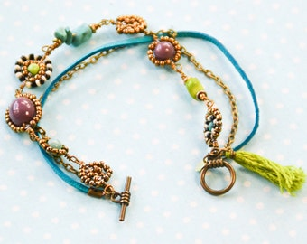 Tribal multi-layered bracelet in gold, turquoise, green and lilac