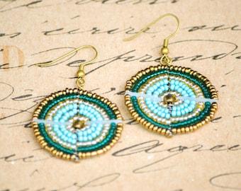Turquoise, teal and gold Maasai bead-work earrings.