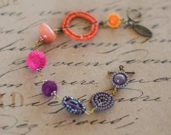 Fun and funky beaded bracelet in orange, pink and purple