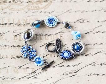 Maasai bead-work bracelet in blues, gun metal and silver.