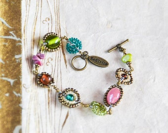 Teal, amber, soft pink, lime green, antique ivory and gold Maasai beadwork bracelet