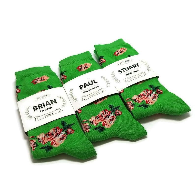 Groomsmen proposal green socks with labels Groom Best Man gift ideas Greenery Woodlnd wwedding ideas for men WInter DEcember weddings