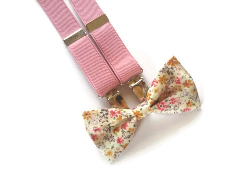 soft pink suspenders and ecru pink mustard floral bow tie for groom and groomsmaids fall wedding attire ideas for ring bearer best man