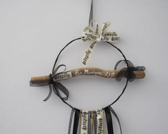 """dream catcher in black and white with Driftwood of the """"in music"""""""