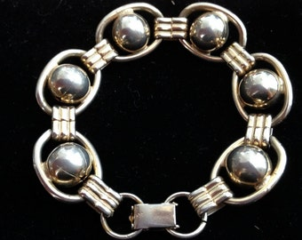 A 1930's-1940's Deco Sterling Bracelet with Gold Overlay.
