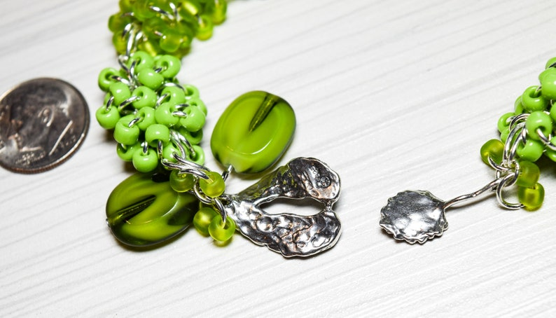 Green Handmade Beaded Bracelet Silver Tone Findings with Sterling Silver Pointed Leaf Interlocking Clasp