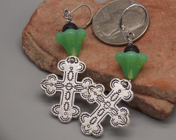 Southwestern cross diffuser earrings. Trumpet flowers are green Jade glass.