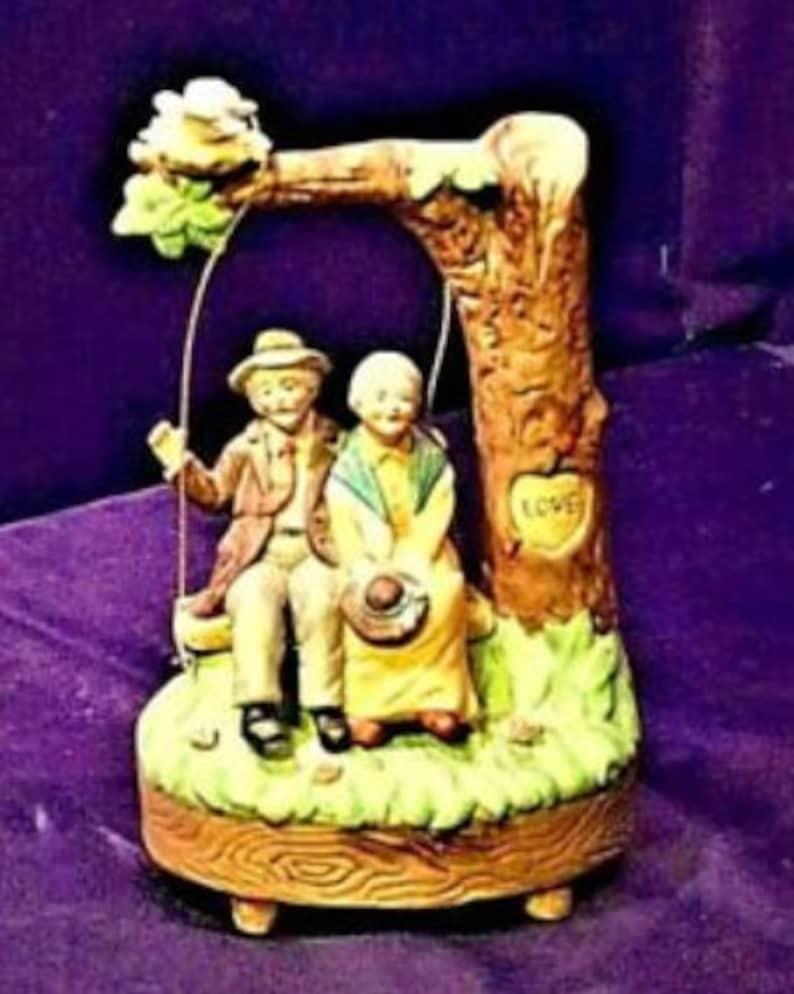 Vintage Man and Woman on a swing Music Box figurine AA19-1395