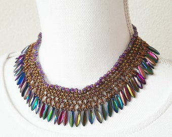Beaded necklace with multi color dagger beads gold and metallic miyuki seed beads with copper coloured toggle clasp.