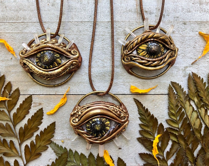 Eyes Of The World Pendant Hand Made Hand Painted Clay Crystal Sunflower Eye Pendants By Melanie Bodnar And Enlighten Clothing Co