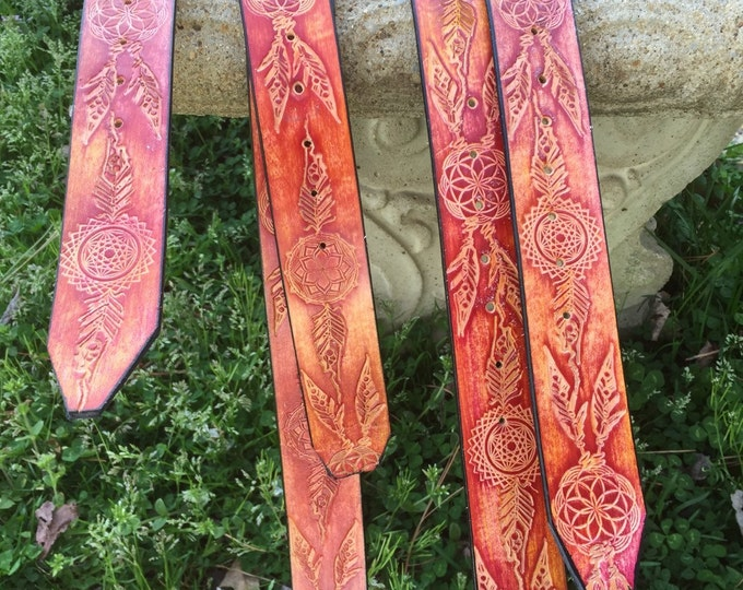 Sacred Feather Leather Belt, hand made by artist Jarred Trantham from Lost Sailor Designs. Red stain, genuine leather.