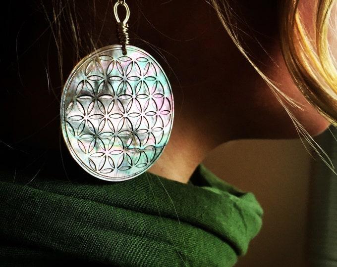 Black rainbow chakras mother of pearl earrings.  Original Sacred Geometry Jewelry by Enlighten