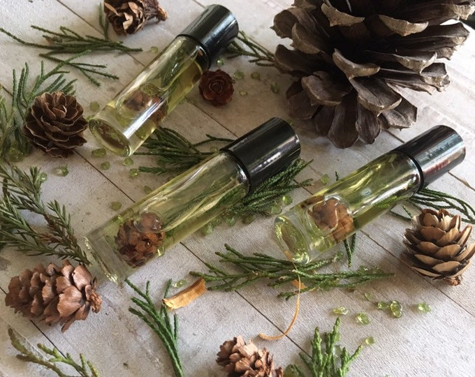 Juniper Body Oil With Crystals Made By Enlighten Clothing Co peridot pine cones