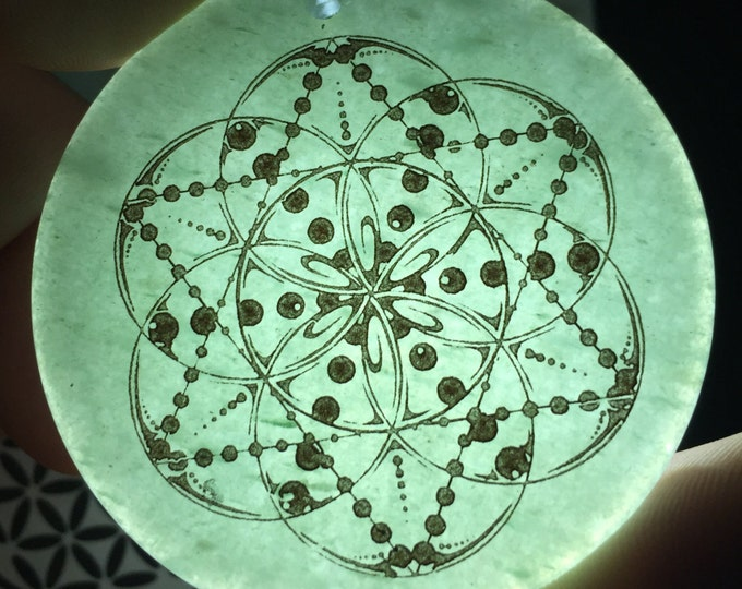 Drop pendant etched into green aventurine by Enlighten Original Sacred Geometry Jewelry. Art by Tyler Epe.