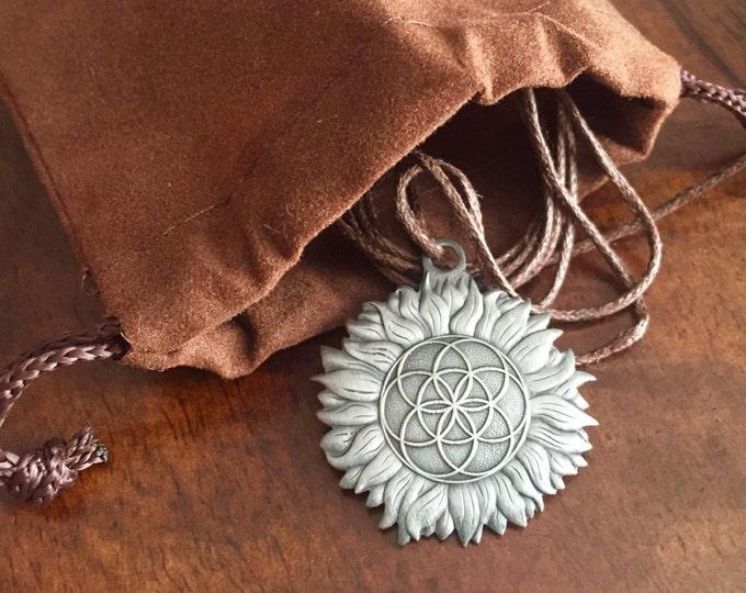 Sun Flower charm, Sacred Geometry Pendant By Enlighten Artist Melanie Bodnar.  Original Sacred Geometry Jewelry by Enlighten