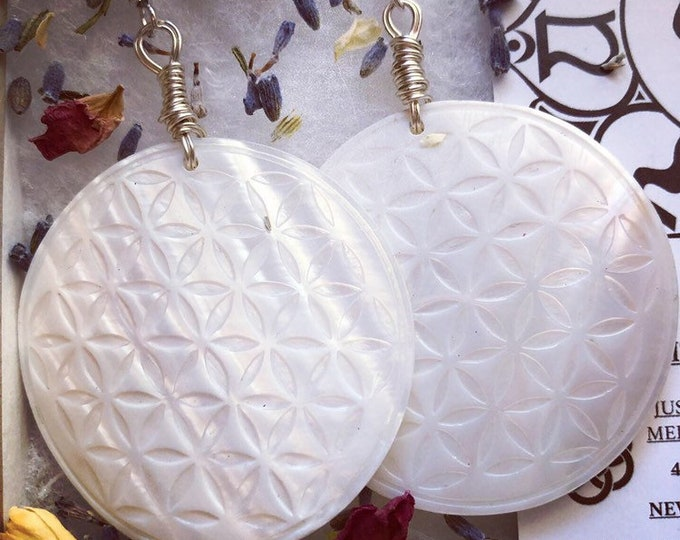 White flower of life mother of pearl earrings.