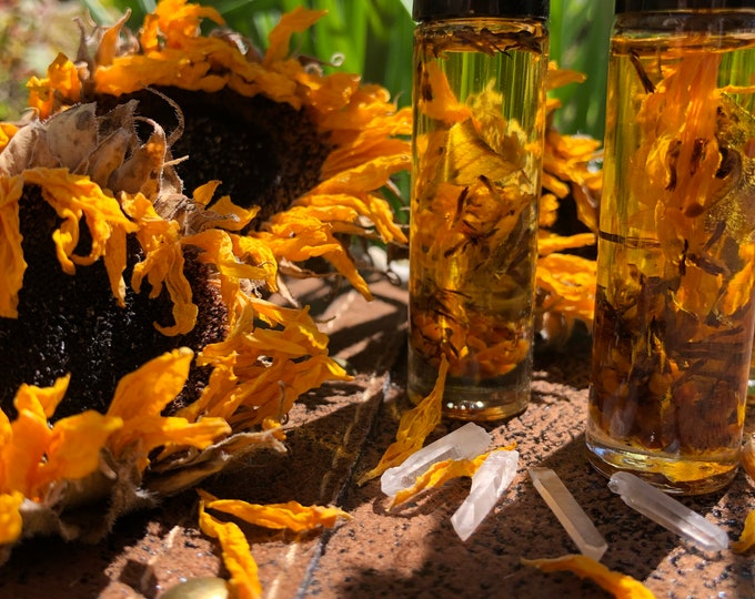 Sunflower Body Oil With Crystals By Enlighten Clothing Co. Dried Sunflowers, Bee Pollen, Quartz Crystals.