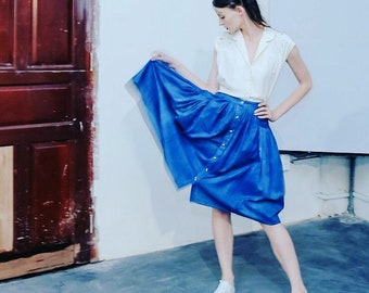 Indigo dyed high waisted flare folk skirt with hand painted white falling leaves, lovely pocket details, accent white buttons, one of a kind
