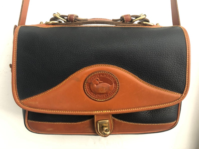 Dooney and bourke navy blue and tan bag