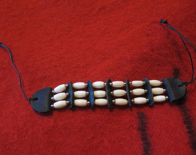 "Native American Bone Hairpipe Bracelet Wristband Made from 1/2"" bone hairpipe Decorated with leather spacers and silver beads."