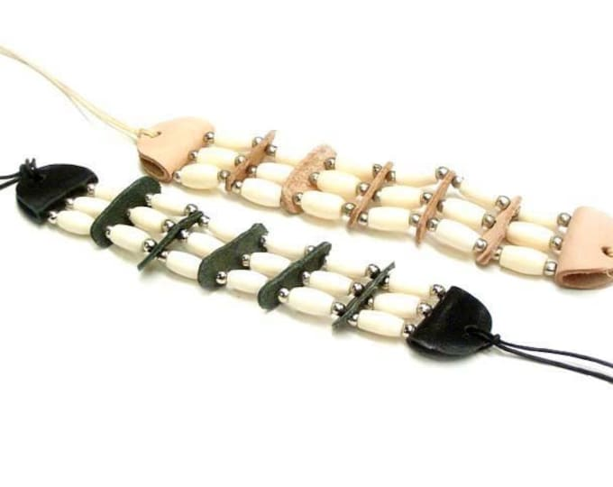 """SALE- Native American Bone Hairpipe Bracelet Wristband Made from 1/2"""" bone hairpipe Decorated with leather spacers and silver beads."""