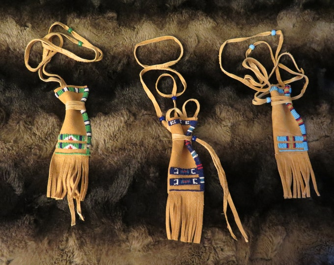 Native American hand made by the Flathead Nation Beaded Brain-Tanned Leather bag these are called Beaded paint pouch this long Medicine bag