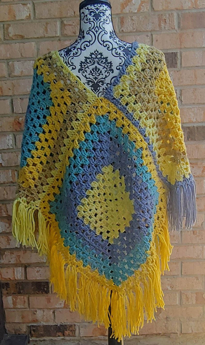 In tones of blue and yellow 1970s themed poncho. Colorful crochet poncho Vintage inspired poncho