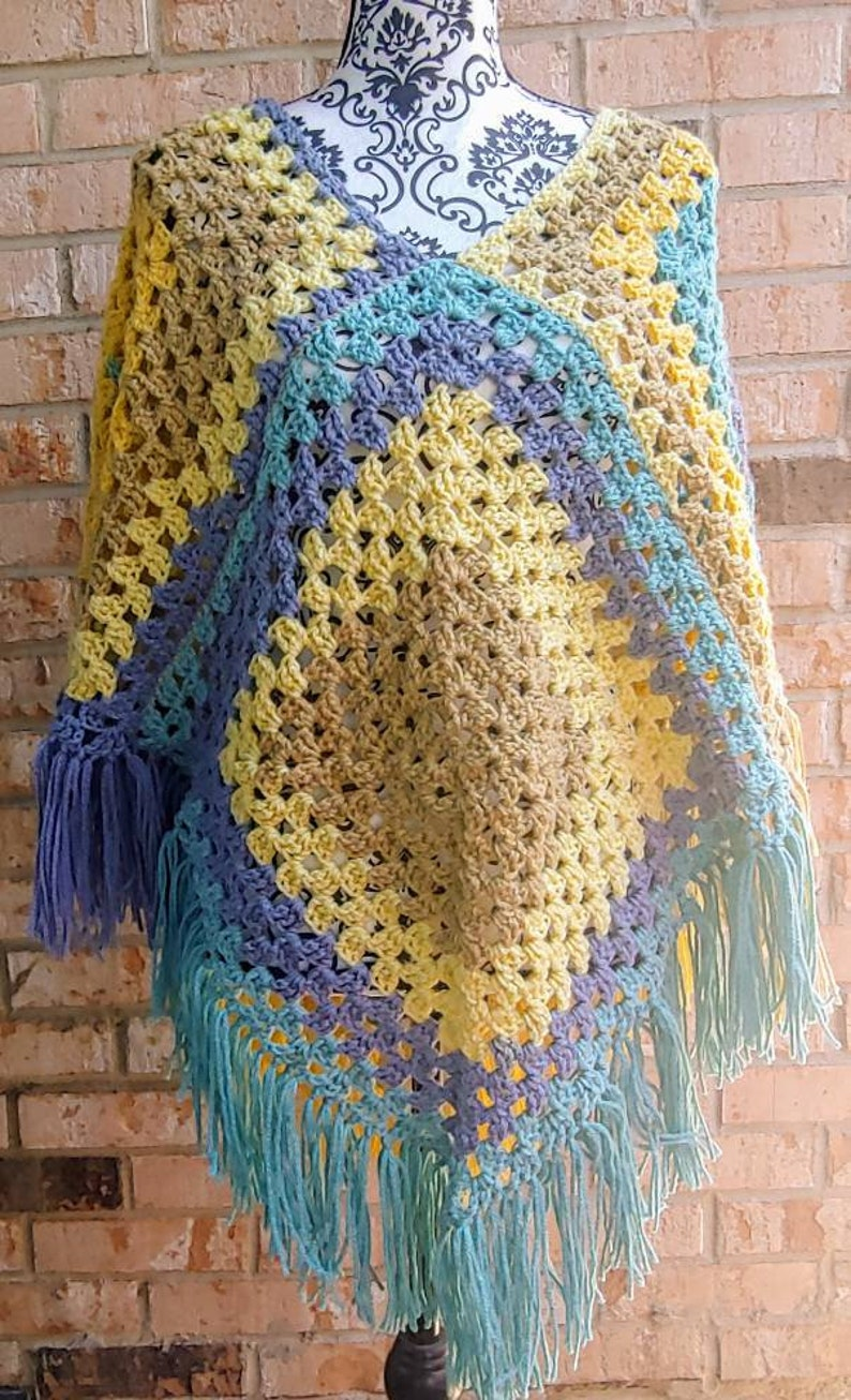 1970s themed poncho. Vintage inspired poncho Colorful crochet poncho In tones of blue and yellow