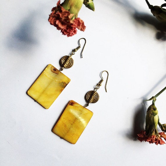 Shell and Akan brass bead earrings