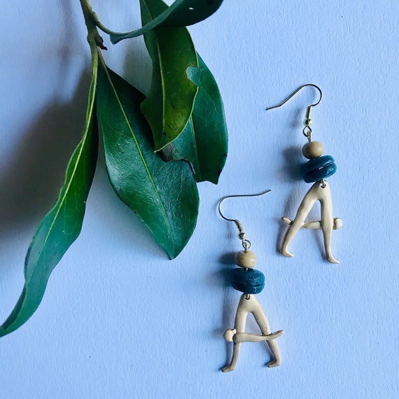 Alphabet brass Body stretch charm and  Handmade Krobo beads
