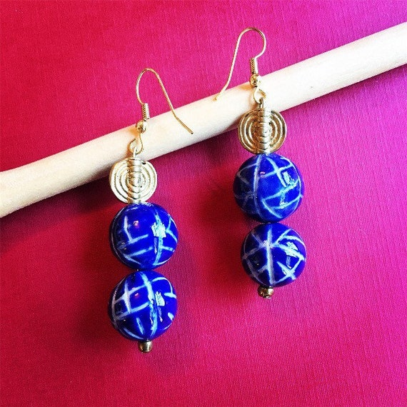 Glass beads and Akan brass charm earrings