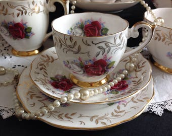 Attractive bone china tea set . Red and white cabbage roses.