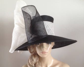 Large black sinamay hat adorned with a magnificent champagne and black bow  detail. ff4da6b495c