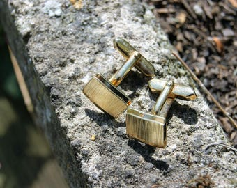 A Pair of 1970's Gold Metal Cufflinks