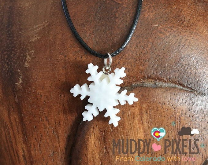 Cute little ceramic snowflake on a corded necklace