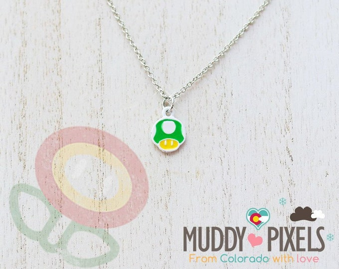 Very Petite Mario Bros Necklace featuring 1uP Mushroom in white setting