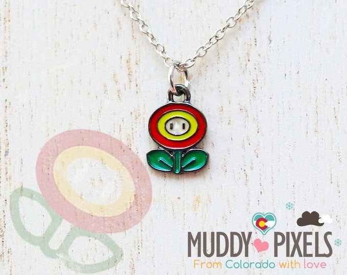 Very Petite Mario Bros Necklace featuring Fire Flower in black setting