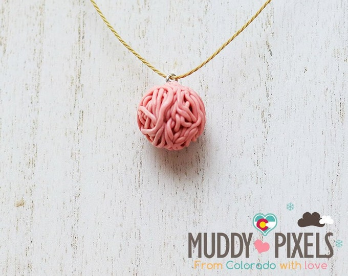Cute little boho style yarn ball themed ceramic necklace
