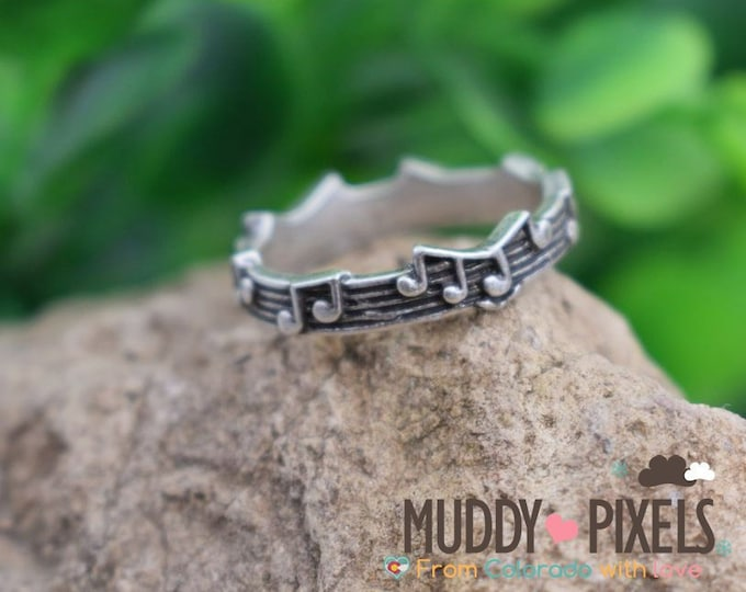 Unique Beautiful Jagged Edge Music note Ring