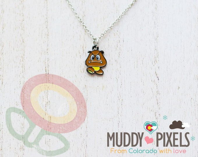 Very Petite Mario Bros Necklace featuring Goomba in black setting
