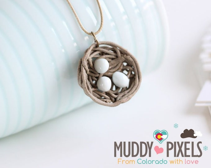 Cute little boho style bird nest ceramic necklace with eggs!