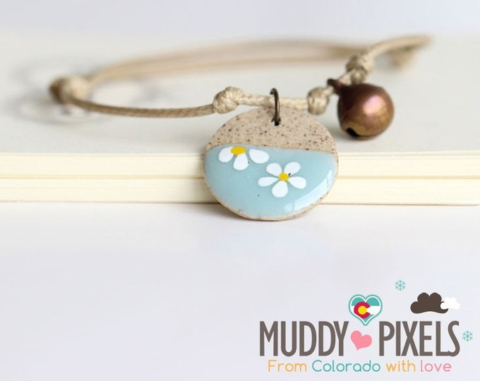 Cute little boho style blue dipped ceramic flower bracelet or anklet!