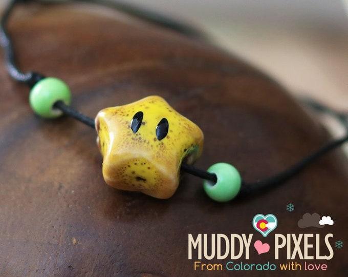 Cute little boho style ceramic Mario Star bracelet or anklet!