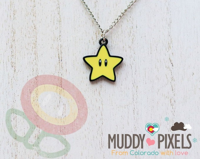 Mario Bros Necklace featuring  Super Star (starman) in black setting