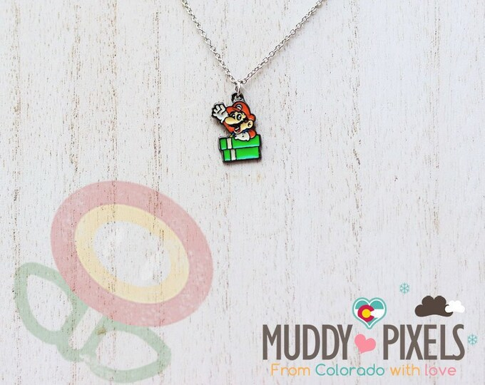 Very Petite Mario Bros Necklace featuring Mario Pipe in black setting