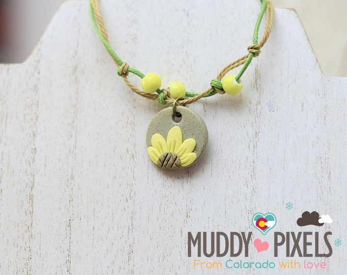Cute little boho style sunflower beaded ceramic flower bracelet or anklet!