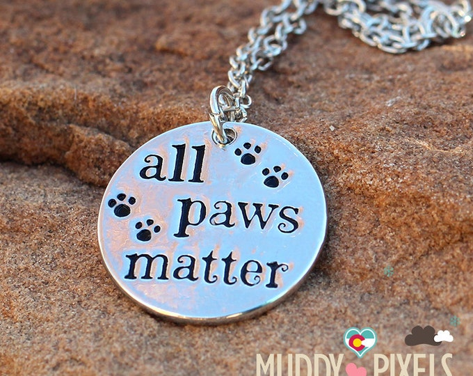 Cute animal rescue stamped paw necklace! All Paws Matter