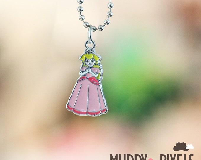 Mario Bros Necklace featuring Princess Toadstool